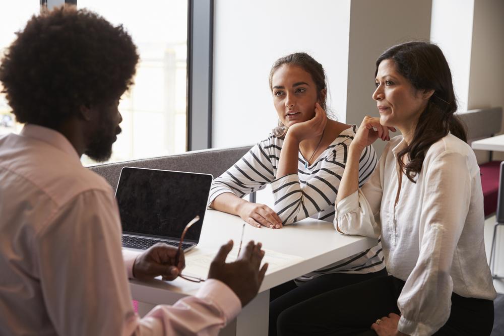 teacher talking with parent